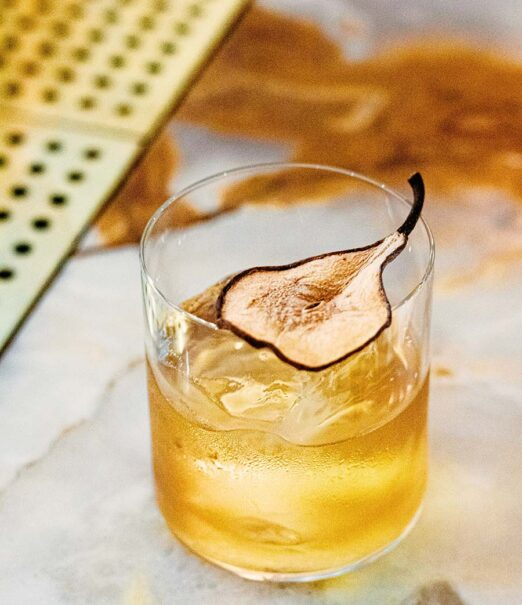 cocktail glass with pear garnish